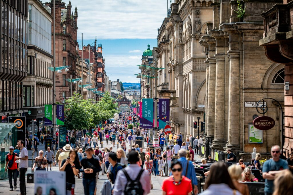 A Street filled with people shopping. How has digital transformation affected them? Credit Artur Kraf
